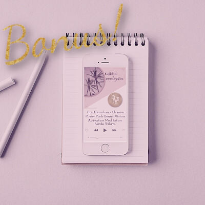 A preview of the bonus Monthly Planning & Review pages in The Abundance Planner